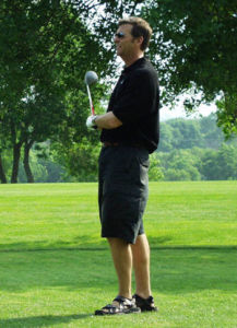Bill Muster on golf course - comp
